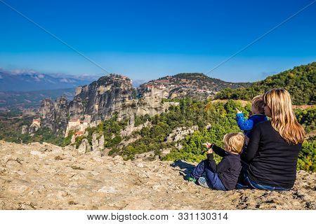 Family Overlooking Meteora - Meteora, Greece, Europe