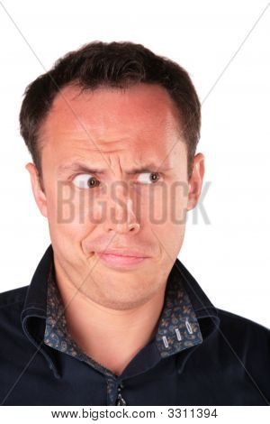 Angry man looks on a white background poster