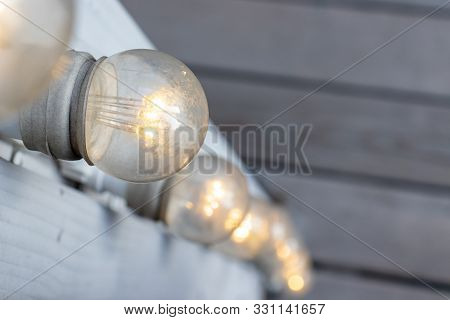 Outdoor Backyard Patio Led Lighting On Wooden Beam With Copy Space, Party Decorations Background.