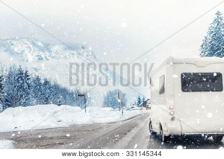 Caravan Or Campervan Turning From Road With Beautiful Mountain Alpine Landscape On Background At Col