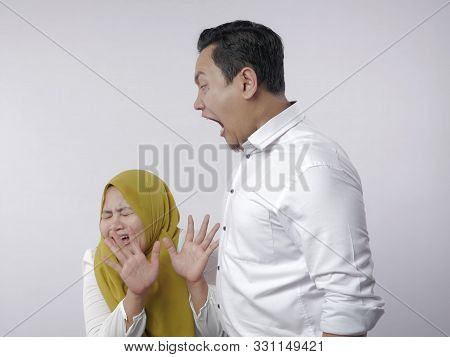 Portrait Of Asian Muslim Couple Husband And Wife Having Fight, Wife Afraid Of Her Husband, Husband S