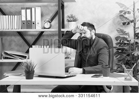 Overwork. He Needs Help. Tired Businessman In Formal Outfit. Confident Man Use Laptop And Smartphone