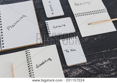 Setting Up For Success Conceptual Still-life, Business Desk With Variety Of Notebooks With Step-by-s
