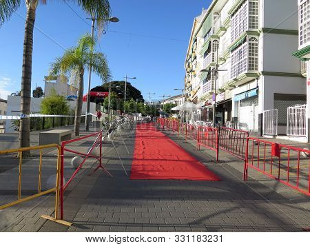 Red Carpet And Barriers In Village Street