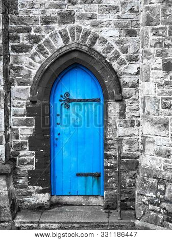 A Blue Church Door Penzance Cornwall With Grey Stone Work And Saturated Blue Colour.
