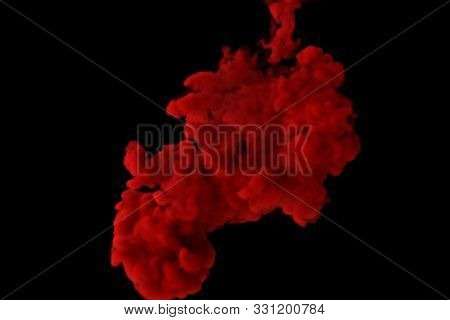Red Ink Burst In Slow Motion On Isolated Black Background. 3d Illustration