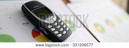 Minsk, Belarus - 18 September 2019: Nokia 3310 Ol Phone With Business Chart. Illustrtive Editorial