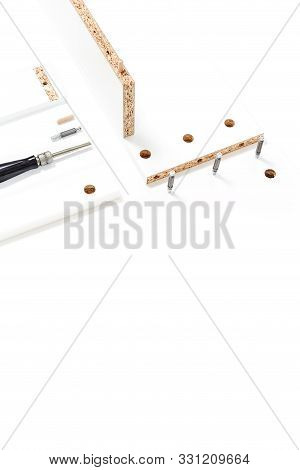 Tools For Assembly Of Flat Packed Furniture On White Background. White Diy Funiture Parts With A Scr