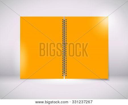 A Orange Paper With A Black Wiro Bind