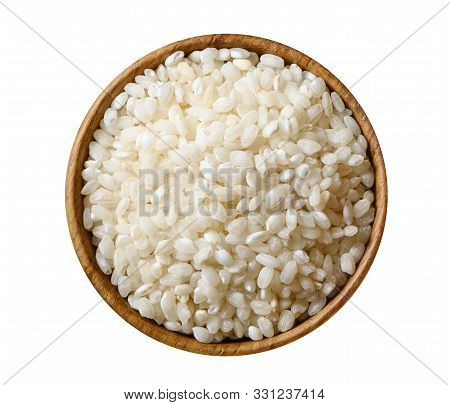 Wooden Bowl With Dry White Glutinous Rice Isolated On White Background. Top View