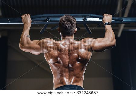 Handsome Strong Athletic Men Pumping Up Muscles Workout Fitness And Bodybuilding Concept Background