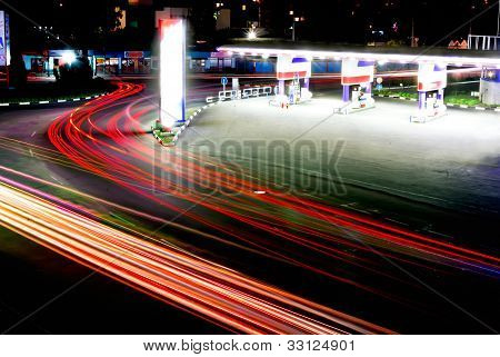 Traffic At Night Near The Gas Station