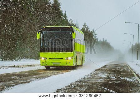 Passenger Bus In Lapland Road In Rovaniemi