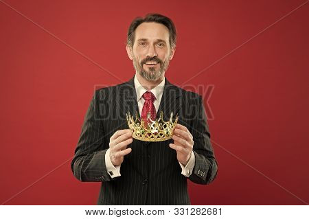 He Is A Big Boss Here. The Old Man Or Big Boss. Proud Boss. Big Boss Holding Jewelry Crown On Red Ba