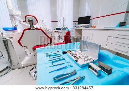 Dentistry, Oral, Medical Equipment And Stomatology Concept - Interior Of New Modern Dental Clinic Of