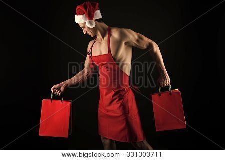 Sexy Athletic Macho Muscular Chest In Santa Claus Hat. Athlete Muscular Man Wear Santa Hat And Apron