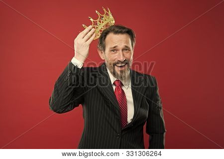 Winner At Life. Successful Prize Winner Putting Crown Jewel On Head On Red Background. Best Company