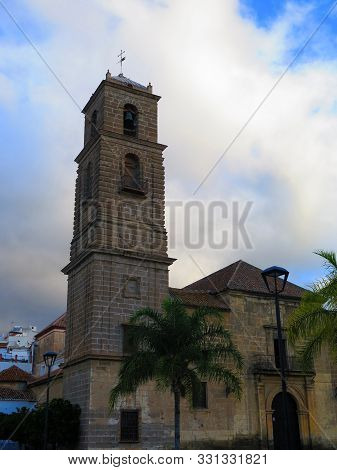 Alora Parish Church Tower And Palm Tree In Andalusia