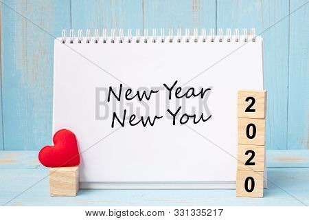New Year New You Words And 2020 Cubes With Red Heart Shape Decoration On Blue Wooden Table Backgroun