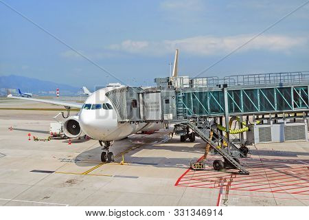 Airport Apron With Passenger Plane And Jet Bridge For Passengers