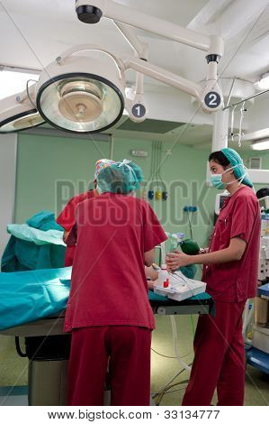 Anesthetic team preparing young patient at the operating theater before surgery