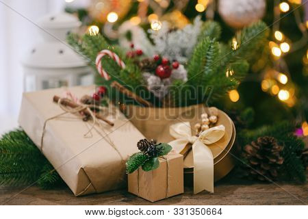 Holiday Christmas Wood Wallpaper With Gift Box. Christmas Card Background With Lantern And Festive D