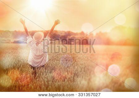 Woman Enjoys In Landscape Of Wheat Field, Woman In Beautiful Wheat Field At Sunset