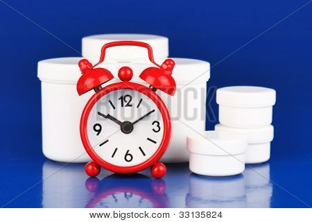 Medications and  small alarm clock