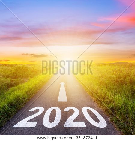 Empty Asphalt Road And New Year 2020 Concept. Driving On An Empty Road To Goals 2020.