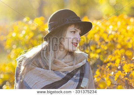 Autumn Portrait Of A Dreaming Woman. A Girl Of 30-35 Years Old Looks Thoughtfully At The Autumn Yell