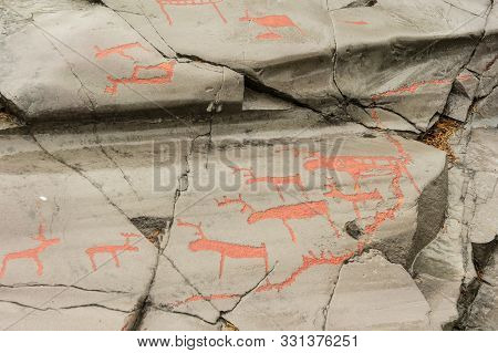 Rock Art In Alta Fjord, Norway. Ancient Symbols, Real Drawing,  Texture In Stone. Red Ocher Paint. H