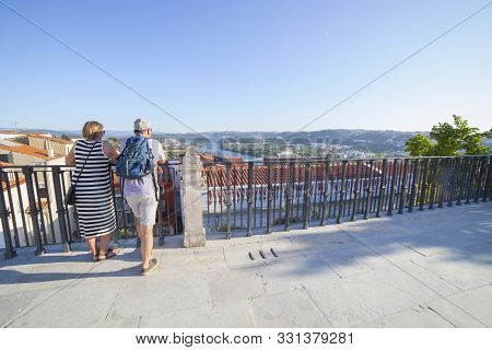 Coimbra, Portugal - Sept 6th 2019: Mature Couple At Viewpoint To Mondego River From University Of Co