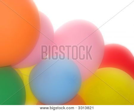 Close-up of gas filled balloons over white poster