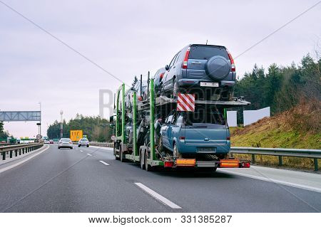 Cars Carrier Transporter Truck In Road Auto Vehicles