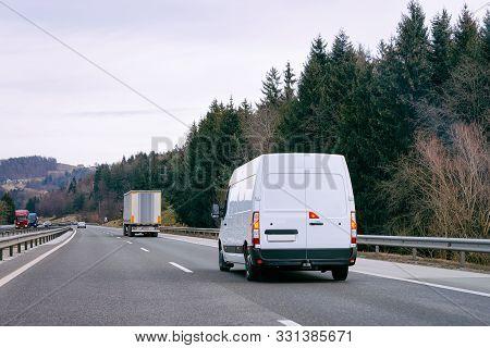 White Minivan In Road Mini Van Auto Vehicle On Driveway