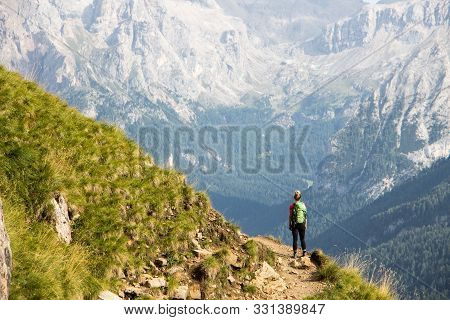 Italy Dolomites Lonely Hiker In Front Of Massive Mountain Rocks View Marmolada