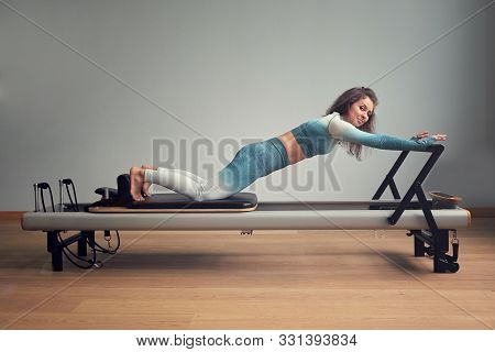 Leotard Workout Pilates Training. Athletic Pilates Reformer Exercises. Pilates Machine Equipment. Yo