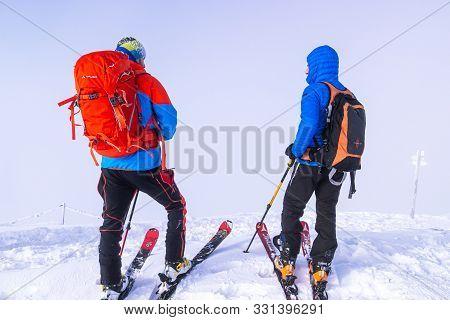 Zakopane, Tatra Mountains, Poland - December 16, 2019 Two Mountain Skiers Travelers With Large Backp