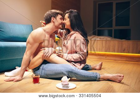 Young Sexy Couple After Intimacy In Kitchen In Night. Cheerful Happy People Touching Each Others Nos