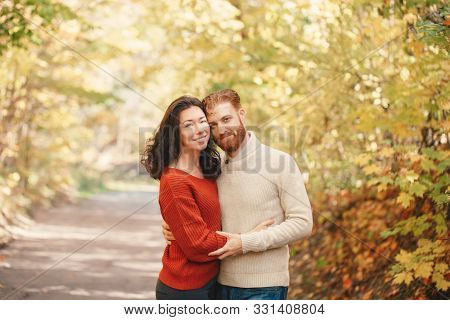 Portrait Of Beautiful Couple Man Woman In Love. Boyfriend And Girlfriend Hugging Tender Outdoor In P