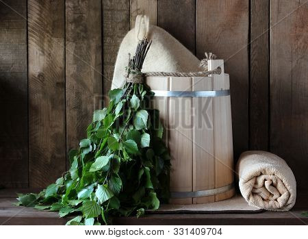 bathhouse. Interior details sauna, steam room with traditional sauna accessories: basin, birch broom, scoop, felt hat. Traditional Russian bathhouse. SPA Concept. Relax country village bath concept. poster
