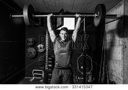 Barbell Weight Training, Young Strong Fit Muscular Sweaty Man With Big Muscles Doing Heavy Barbell W
