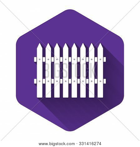 White Fence Wooden Icon Isolated With Long Shadow. Garden Fence Sign. Purple Hexagon Button. Vector