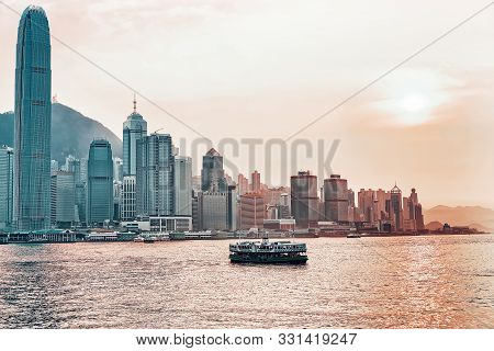 Star Ferry At The Victoria Harbor Of Hk At Sundown