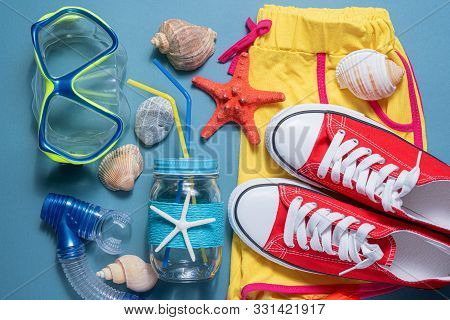 Summer Vacation Concept Flat Lay Background. Beach Accessories. Scuba Mask, Seashells, Red Starfish,