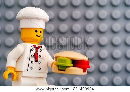 Tambov, Russian Federation - October 19, 2019 Lego Chef Minifigure With Hamburger Against Gray Basep