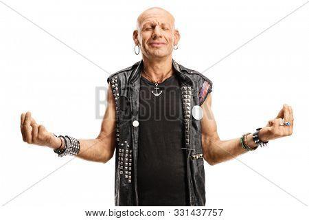 Hardcore punker meditating isolated on white background