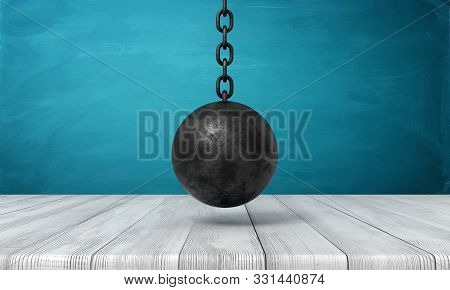 3d Rendering Of Black Wrecking Ball Hanging Above Wooden Surface.