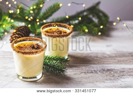 Eggnog With Cinnamon And Nutmeg For Christmas And Winter Holidays. Homemade Eggnog In Glasses On Woo