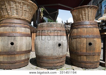 Old Empty Wooden Cider Casks Used As Bar Tables And Decorative Articles
